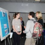 Meeting participants discussing poster presentations.